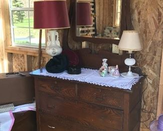 Dresser with ornate mirror that is perfect for chalk painting