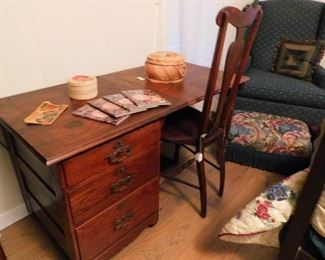 Antique sewing cabinet, (the part above the chair folds down against the cabinet when not in use)
