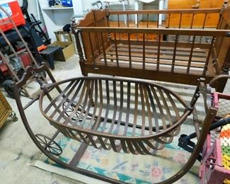 Antique baby cribs, the swinging crib w/wheels was used for mothers working out in the cotton fields to pull along so their babies could be with them.