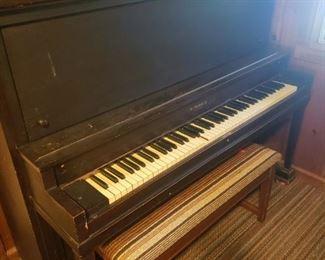 Piano, bench, sheet music.