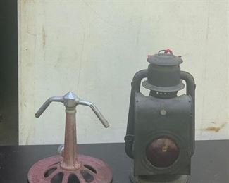 Vintage sprinkler and railroad lantern