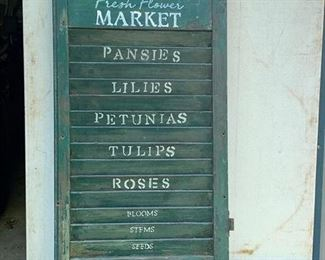 """Farm Market"" sign on old green painted shutter"