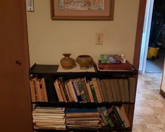 Antique books, art, bookcase, pottery