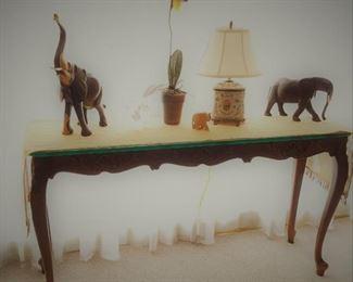 Elephants on long table