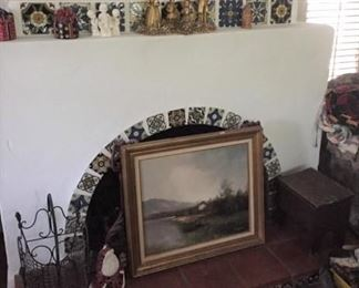 A painting, small chest, and display figurines.