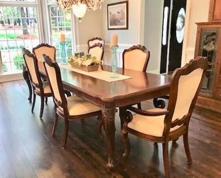 """Dining room table with two leaves measures 9'3"""" long. With two leaves removed the table measures 6ft. in length."""