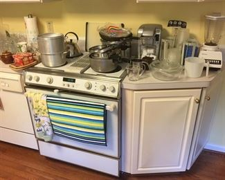 blender, keurig  coffee maker, pots and pans, pyrex, plastic containers,lots of glassware