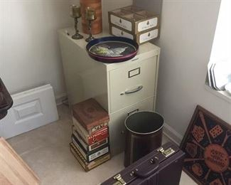 file cabinet, briefcase, old cigar boxes, lamp, chopping block, nice new glasses
