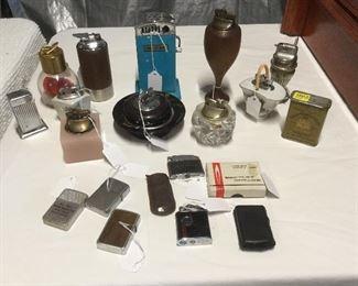 Vintage cigarette lighters and table lighters.
