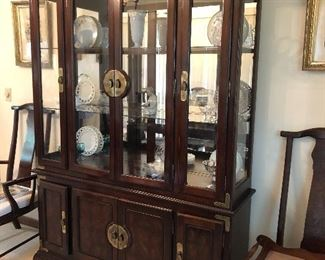 Oriental style lighted china cabinet