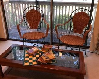 Pr iron and wicker chairs glass top coffee table old checker sets and game books