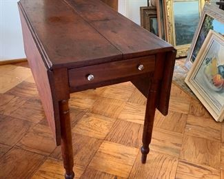 Primitive drop leaf table with side drawer and peg legs