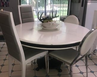 Main Floor Dining Area: round white/black/gray pedestal table & chairs