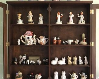 "Hundreds of vintage small pottery pieces here, including Lefton ""Miss Priss"" set (6 pcs.); Enesco skunks, and three Czechoslovakian Royal Dux figurines."
