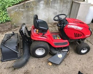 Troy-Bilt riding lawn mower with complete bagging attachment.
