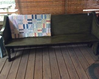 Church pew and quilt