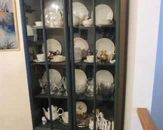 vintage china cabinet with collections