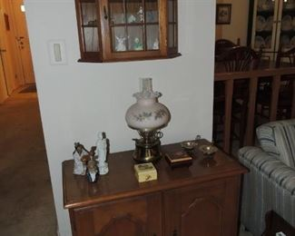 hanging curio with collections and record cabinet
