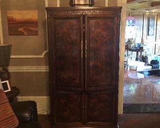 Beautiful inlaid armoire.