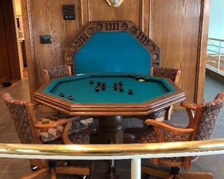 Fabulous game table doubles as a dining table and seats up to eight!  The flip side of the table top is a game table with cutouts for drinks & chips.  Under the cover is a bumper pool table.