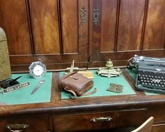 Vintage desk top items, with a huge antique desk
