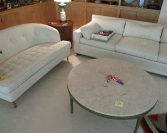 Dunbar Settee and a marble top coffee table.