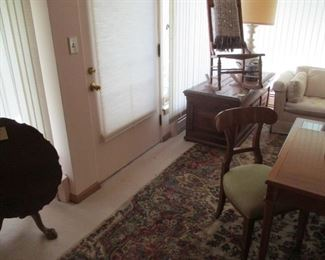 Kermin rug, carved chest, Baker table with 2 chairs