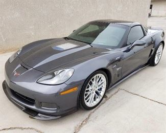 #125: 2011 Corvette ZR1, Under 6k Miles! See Video! Sold on Non-op! Beautiful car inside and out! Car is currently on non-op and will be sold on non-op. Can be transferred in California. We have stock parts including headers, catalytic converter, the mufflers, and more. Also includes factory driver seat. Adding photos soon. California title in hand.  DMV fees: $80 for NON- OP only and $70 doc fees   Year: 2011 Make: Chevrolet Model: Corvette Mileage: 5,971 Body Type: 2 Door Coupe Trim Level: ZR1 Custom 3RZ Drive Line: RWD Engine Type: V8, 6.2L; SFI Fuel Type: Gasoline VIN #: 1G1YN2DT0B5800476