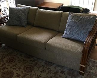 Nicely upholstered bamboo Queen sleeper couch. Two accent pillows.