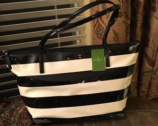 """Kate Spade"". We believe this one to be authentic, but can not legally guarantee anything."