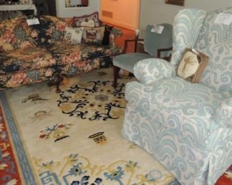Ball-claw foot sofa, oversized new wingback chair.  Large rugs