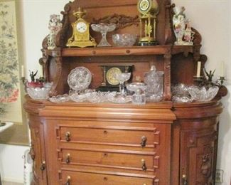 Cut glass, sideboard, figurines, and two special clocks