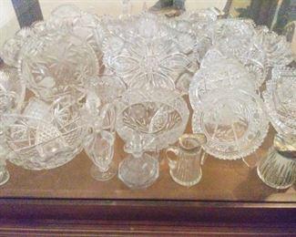 Cut glass bowls, zipper cut cream pitchers.