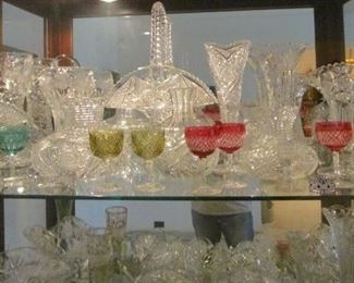 Cut glass whimsies, desirable wine goblets, vases, baskets are shown from the more than 200 pieces of fine quality cut glass