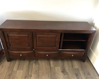 T..V. armoire with sliding cabinets for plenty of storage: $325. 3 drawers measures 68x32