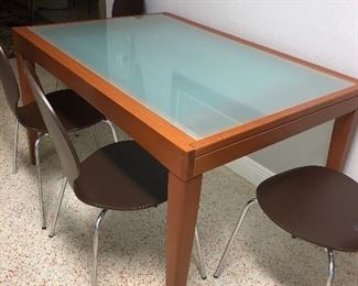 Dining table glass and wood.  Extends to fit 8 chairs.