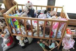 crib full stuffed toys