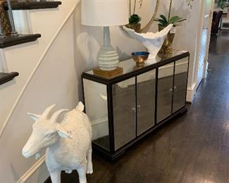 Mirrored buffet/entry piece. Welcoming white goat.