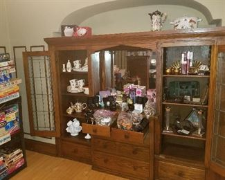Built in hutch full of beautiful handmade collectibles and a large selection of jewelry, watches and fragrances.