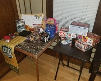 Toys and model cars, a 100 year anniversary Green Bay Packers banner, etc.