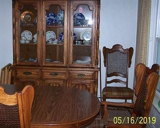 Dining room suite including table, 3 leaves, 2 Captain's chairs, six chairs and hutch.