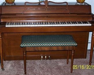 Spinet piano and bench
