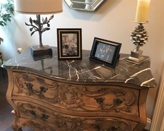 marble top and carved chest