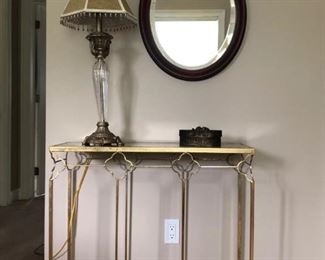 gold and gilded glass console table and antique cherry mirror
