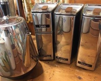 Bright and shiny vintage coffee perculator by Sunbeam and set of 4 canisters with teak knobs by Lincoln.