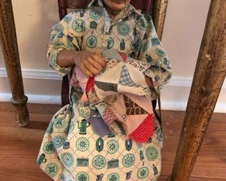 grandmother quilting doll