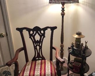 ornate arm chair, side table, lamp