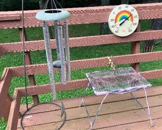 wind chimes, outdoor thermometer, wrought iron table