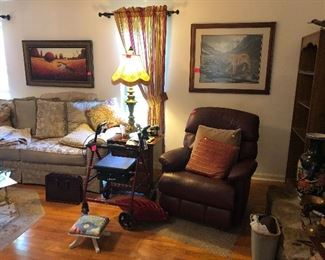 sofa, leather recliner, small foot stool, rolling walker