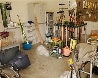 Yard tools, plastic garage storage, short and tall